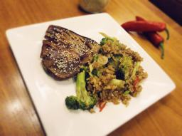 Soy and sesame tuna steaks with stir fried brown rice